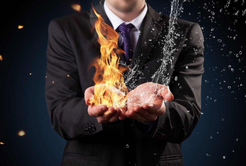 person holding both fire and water in their hands