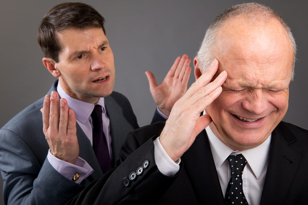 Person having difficult conversation that other person doesn't want to hear