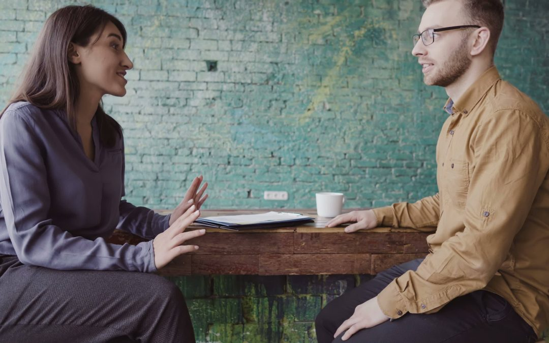 Two employees talking in a casual environment