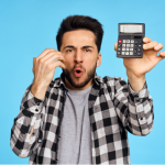 Man holding up calculator