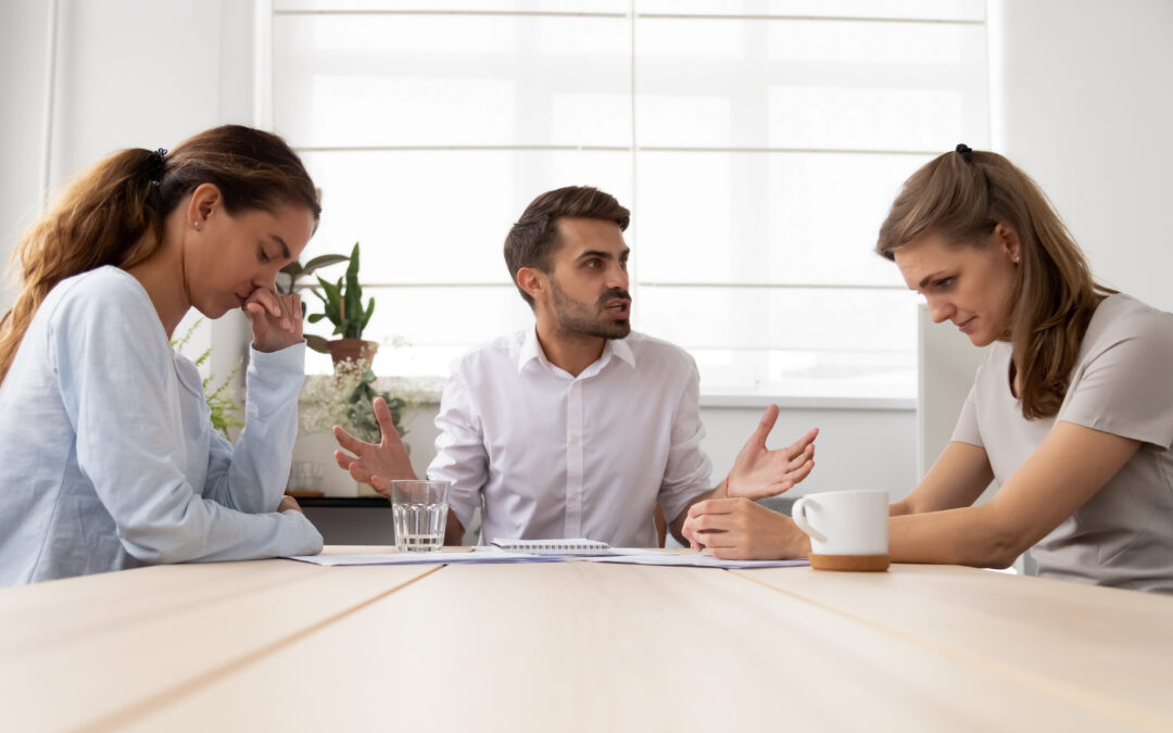 Annoying man meeting with two colleagues